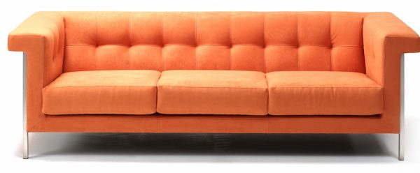 Bottlebrush buttoned fabric sofa in oraange fabric